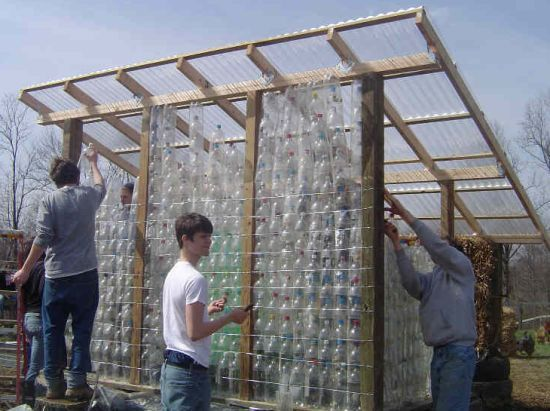 Created by Blue Rock Station, this greenhouse has been entirely made from recycled plastic bottles. The project involves the use of more than 1000 2-liter plastic soft drink bottles. The north wall was raised by building 55-gallon rain barrels one over another. The whole structure stands still on a foundation made out of recycled tires.