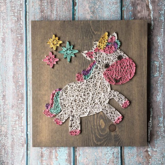 This adorable unicorn is a perfect addition to a nursery, playroom, or bedroom ... or would also make a great gift! This listing is for a string art unicorn sign measuring approximately 12 x 13. Board is stained with our gray stain, as pictured above, unless otherwise requested. Please list your color choice in the note to seller if youd like something different than pictured. String color options can be seen on the last picture. (NOTE: The board shown above is 9.25 x 10 but is not a…