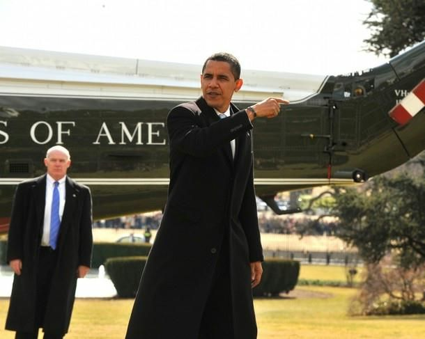 U.S. President Barack Obama gestures towards the Oval Office after arriving from Chicago aboard Marine One on the South Lawn of the White House February 16, 2009 in Washington, DC. The Obamas spent Presidents Day weekend at their home in Chicago.
