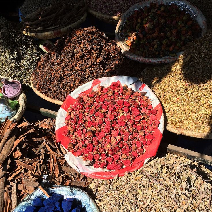 Basket of dried pomegranate flowers amongst herbs and spices in Marrakesh old medina souk. #Morocco www.andrewforbes.com #luxestyletravel #luxurytravelpursuits
