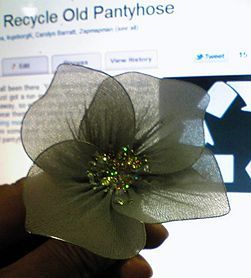 Recycling pantyhose.  Cut hose in short lengths...place wire inside the 'doubled-sided' section. Shape the wire for a flower or leaf. Glue the wire to the hose. Cut off extra hose.