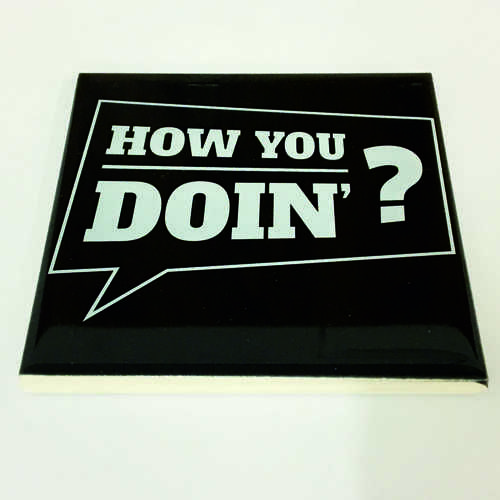 """White Ceramic Tile Coaster, perfect for any fan of the hit TV show Friends – Featuring Quote """"How You Doin'?"""" as said by Joey.  Printed at Uveeka's HQ Full colour high quality printing Scratch Resistant, Shower Proof Size – 100 x 100mm High Quality Ceramic Used Gloss Finish"""