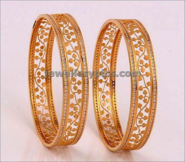 Dazzling gold Fancy Bangles interwined in leafy pattern between Duo textured bangles. Elegent white stone finishing on borders added th...
