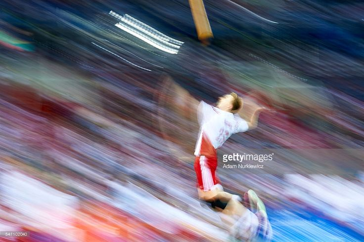 Mateusz Bieniek from Poland serves the ball while the FIVB World League volleyball match between Poland and France at Tauron Arena on July 13, 2016 in Krakow, Poland.