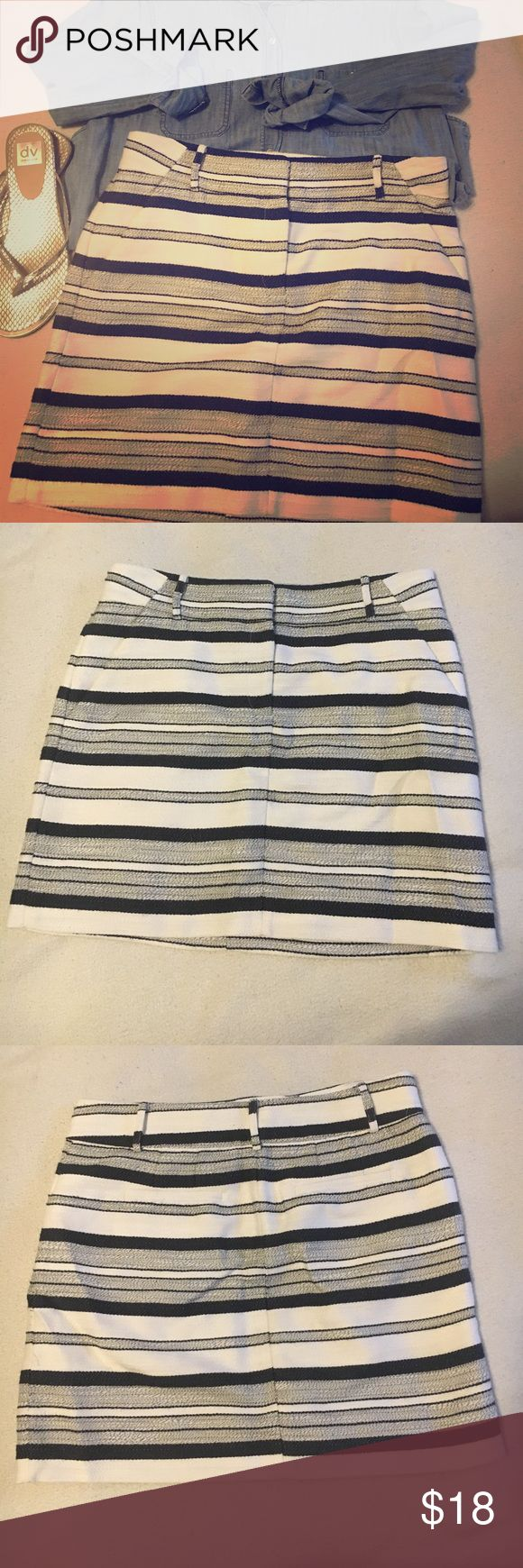 """NWOT LOFT white and navy striped skirt NWOT LOFT white and navy striped skirt. Lovely texture and lined. Has pockets in front and back and belt loops. Length of 17"""" and waist is 16.5"""". This would look great with a chambray shirt! LOFT Skirts"""