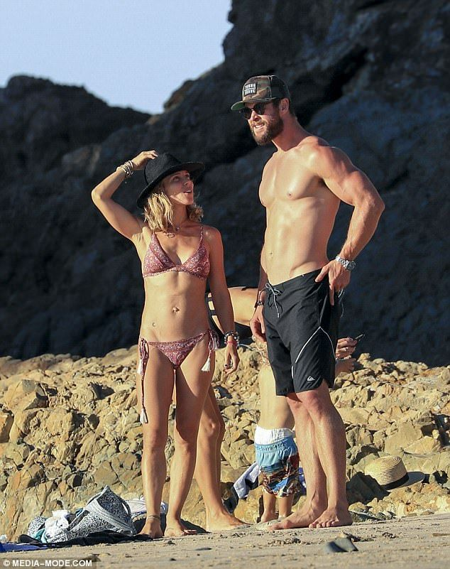 Going strong:Chris Hemsworth and wife Elsa Pataky are as smitten as ever as the pair put on an affectionate display at the beach, late last month
