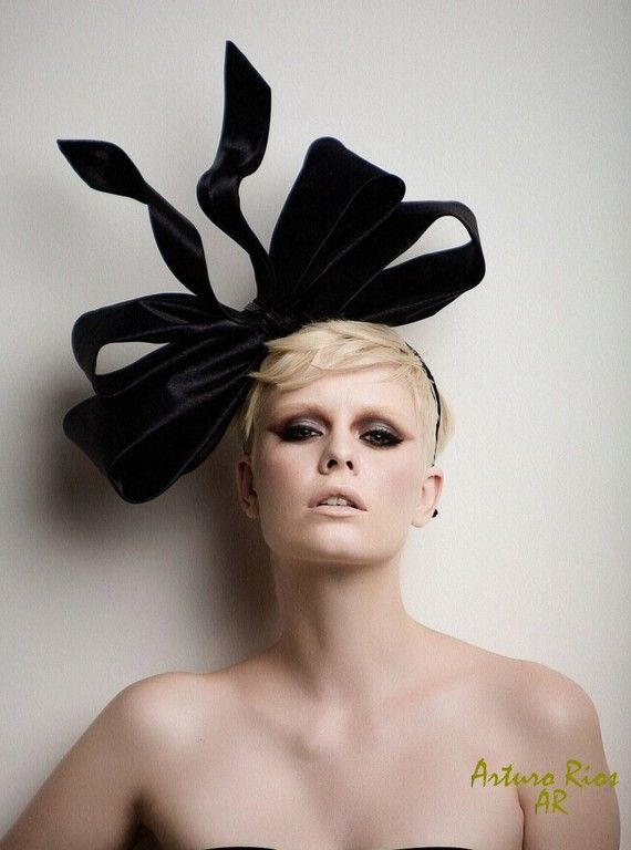 I love checking out the crazy hats in this shop, but I especially love the makeup on the models. ArturoRios on #etsy