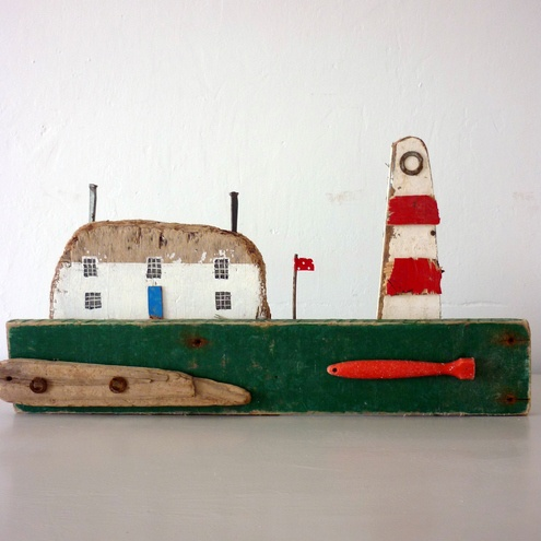 Driftwood cottage with lighthouse ~ Kirsty Elson