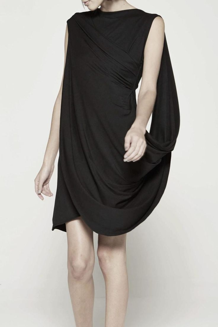 Curve-creating drape dress with cape-like overlayer.Beautiful black edgy dress, you can pair with stilettos and accessorize with jewelry.   Black Drape Dress  by Drifter. Clothing - Dresses - LBD Toronto, Canada
