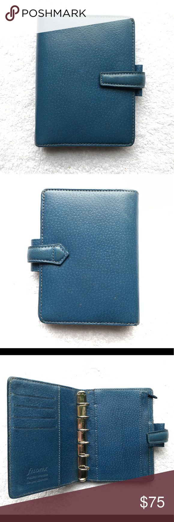 FILOFAX Blue Pocket Pimlico Planner Agenda Wallet FILOFAX Blue Pocket Pimlico Planner Agenda Wallet - Excelkent Gently Used Condition! No visible wear  4 inches wide by 5 1/2 inches high by 1 inch deep  Four interior credit card slots, one interior slab pocket, one enters a pocket, one large back interior money and paper area. Six ring binder  15mm Ring Size Filofax Bags Wallets