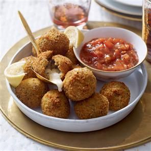 Mozzarella-stuffed risotto balls. These cheesy balls make an enjoyable starter or canapé. You can also try them with taleggio or camembert, cut into cubes.