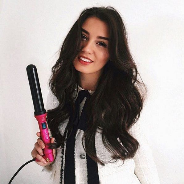 @milenalesecret has got us lusting over her long dark locks . She's a total head turner in luscious thick curls that slay all day . She used the 32mm Classic Wand to get this stunning hairstyle . #hairoftheday #NuMeStyle #loosecurls