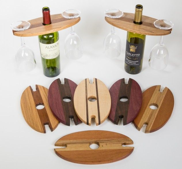 Wine glass and bottle displays. Made out of red oak, mahogany, maple, walnut, and purple heart.