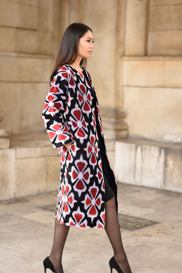 Knee length jacket with red and white floral pattern, dressed with a smart black dress, tights and black stilettos by Asel Nova