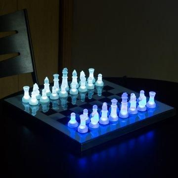 Glow Chess Set - have a board with a pin light in each square, with glass pieces that refract the light to glow.