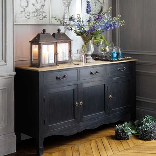 Renew an old buffet and paint it black. Change out the knobs and you'll have a striking piece for years to come.