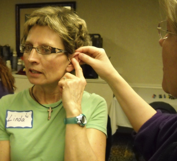 Working on lower back reflex. Ear Reflexology. www.AmericanAcademyofReflexology.com