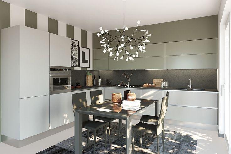 Un lampadario dalla forma particolare che pare un fiore in questo tripudio di verde naturale. #LaCasaModerna #Living #Kitchens ● lacasamoderna.com