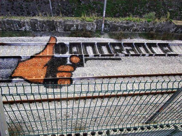 Street Art On The Railroad Tracks by Artur Bordalo  http://restreet.altervista.org/artur-bordalo-usa-i-binari-della-ferrovia-come-tela/