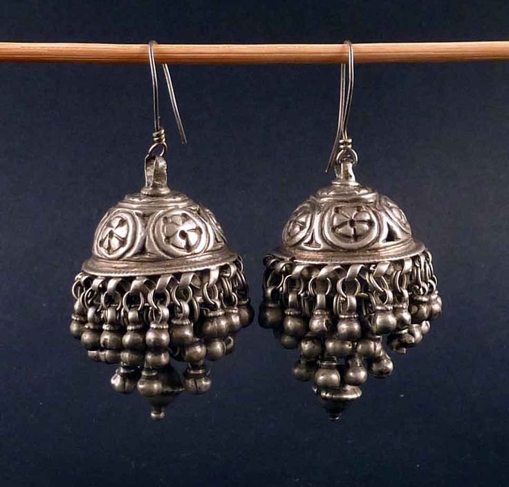 Old Rajasthani earrings from India, made of silver. Nice embossed and etched work on good silver.  The earrings are 6 cm long including the loop