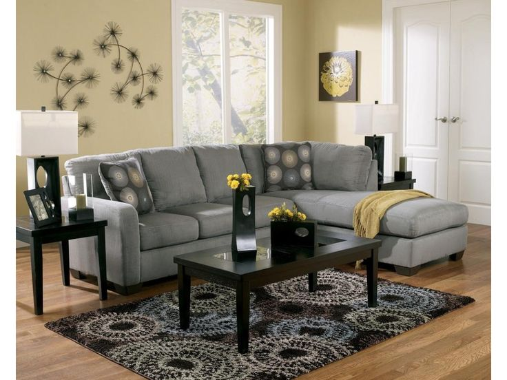 Enjoy the comfortable design of this contemporary sofa sectional. It has plush cushions and soft upholstery and creates a sleek style with it track arms and soft gray upholstery. With its right arm facing chaise, this sectional creates an inviting atmosphere in any home.