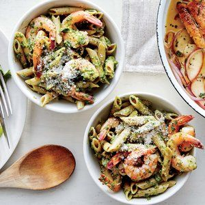 Kale Pesto Pasta with Shrimp | MyRecipes  Making pesto out of leafy greens is a great way to pack lots of veggies into each serving of pasta. While traditional pesto uses basil, a kale pesto is equally hearty and fresh, plus it's loaded with antioxidants and protein.