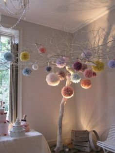 Love pom poms! Might make some for next Christmas...might look good on the tree...great home styling idea if i can find i lovely branch to hang them from.