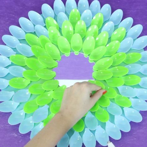 So cute in a kid's room or spray paint any color you like for anywhere you like! SO EASY, mirror surrounded by plastic spoons!
