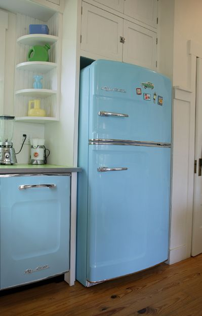 Retro BigChill matching blue fridge and dishwasher with white shaker cupboards. Take a close look at the countertop, too. It's a solid green formica with 50′s style chrome edging