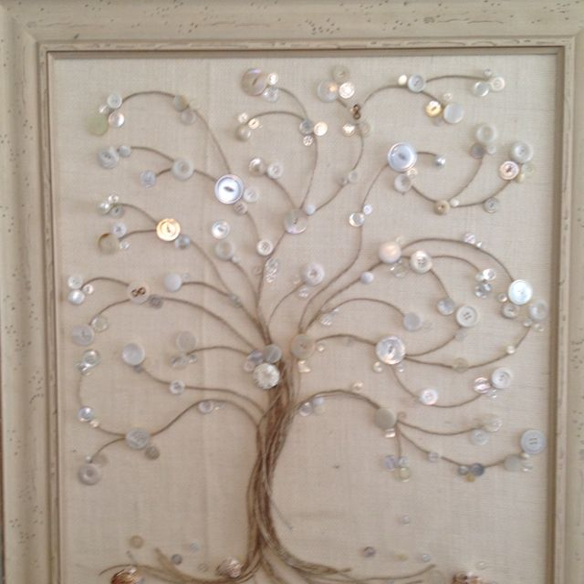 Vintage button tree, using old buttons, jute, sea shells and burlap. All was applied with hot glue gun.