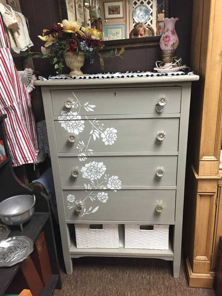 Vintage Repurpised 5 drawer dresser. Chalk paint (castle) and white rose stenciling. Bottom drawer was damaged so I created a storage space with two baskets
