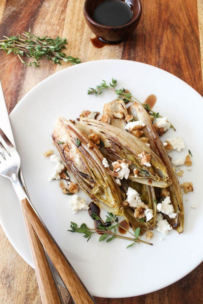 Simple Sautéed Belgian endive salad with goat cheese, balsamic reduction, and chopped walnuts via www.spanglishspoon.com