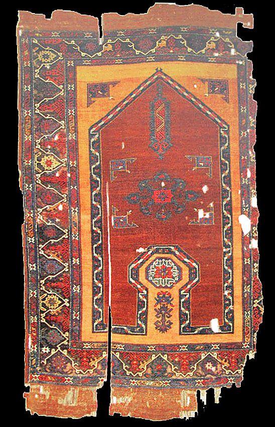 OTTOMAN CARPETS IN THE XVI - XVII CENTURIES (16-17TH CENTURIES)  'Bellini' re-entrant carpet, XVI-XVII century, Western Anatolia, Ottoman Empire. Turk ve Islam Eserleri Muzesi, Istanbul