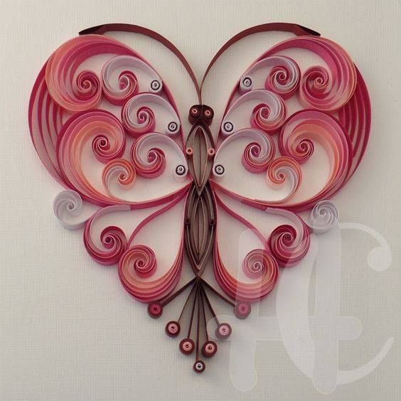 A Butterfly in the shape of a heart - quilled by: Unknown Artist