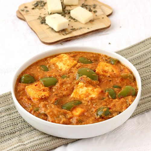Paneer Capsicum Curry - Indian style capsicum curry with cottage cheese in tomato and onion based gravy - Perfect to serve with butter naan or paratha or kulcha in lunch or dinner - Step by Step Photo Recipe