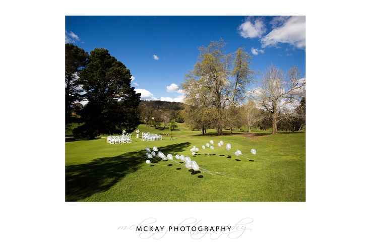 Gibraltar Hotel Bowral - outdoor wedding set up on the golf course with balloons  By McKay Photography - www.mckayphotography.com.au