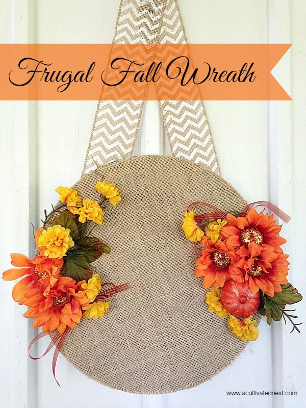 Made from just a few dollar store materials, this pretty fall wreath is a fresh spin on the traditional idea of a wreath. Costs UNDER $10 to make and is super cheap frugal craft. Great for kids to make as well as adults!