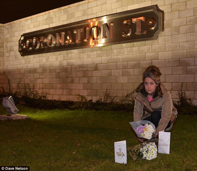 Tribute: Amy Malloy  from Manchester lays flowers outside the Salford studios where Corrie is filmed