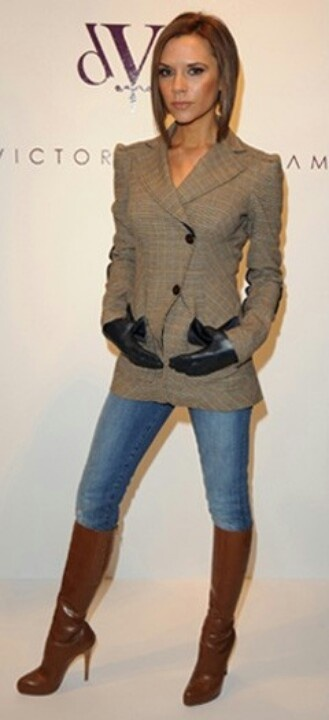 V.Beckham is the most lovely outfitted lady ever. Even with Brown & Black leather.