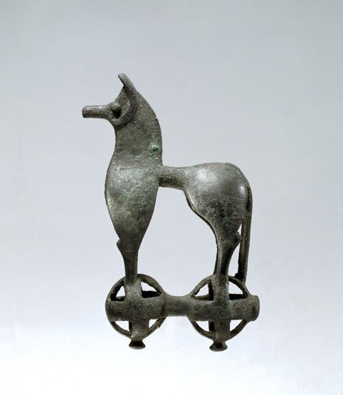 Greek bronze horse on two openwork spheres, Geometric period, 720-690 B.C. Probably a pendant and hung from the waist; possibly a votive hung from the branch of a tree in a sanctuary. Though its use as a rattle has been mentioned, we do not think it likely, since to our knowledge none of the openwork spheres from Central or Northern Greece have ever been found with a ball still inside, 9.9 cm high. George Ortiz collection