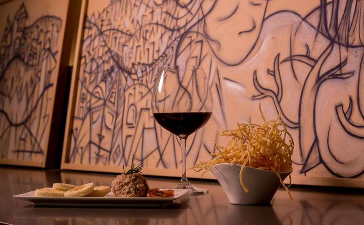 Duck fat fries and pork rillette with a glass of Domaine du Pelican Arbois Trois Cepages at the High Treason wine bar in S.F. Photo: John Storey, Special To The Chronicle