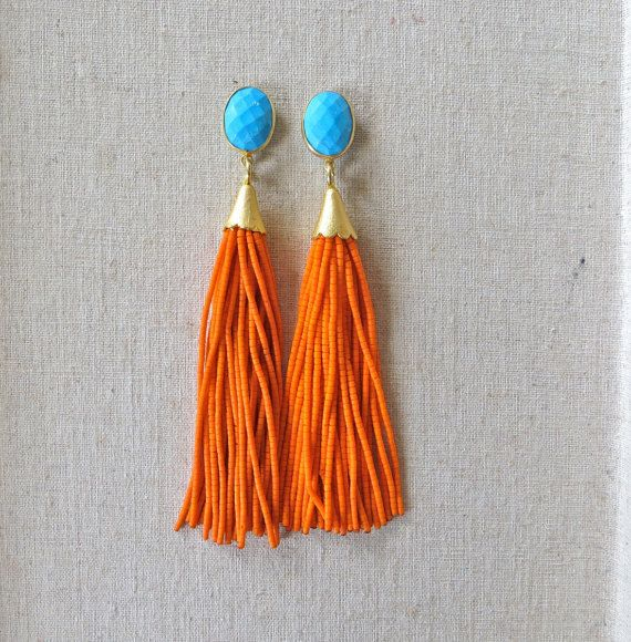 These earrings are turquoise ear posts with orange beaded tassels. They are 4 in. long and come in a variety of different colors. If there is a color