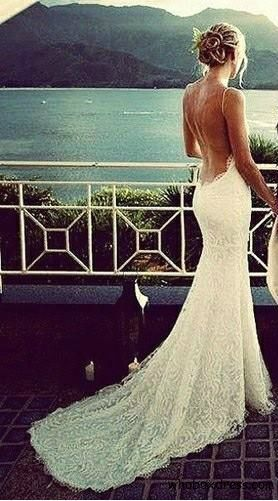 Most gorgeous low back wedding dress.