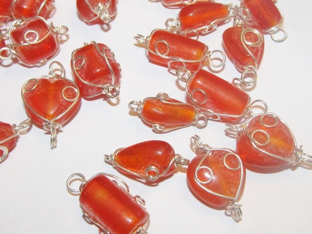 22 Orange Glass - Wire-wrapped Beads. Starting at $1 on Tophatter.com!
