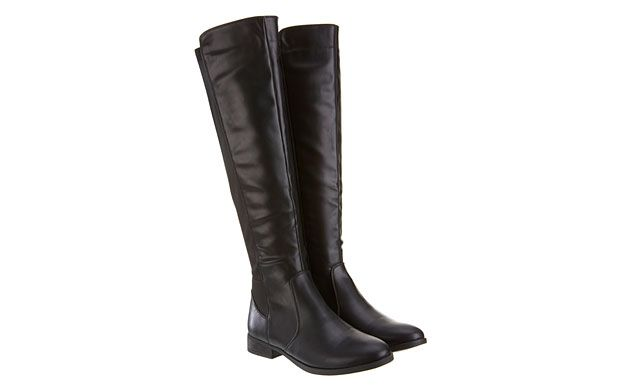 "Leather Riding Boots. ""Get into the spirit of the season with these simple and stylish riding boots."""