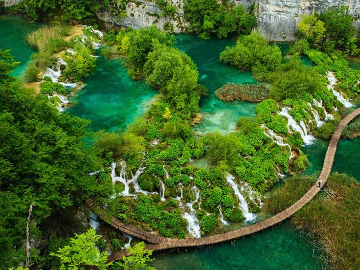 """Plitvice Lakes National Park, Lika-Senj and Karlovac counties, Croatia - a World Heritage site including 16 lakes connected by a series of waterfalls. Picture: Kelly Cheng/Getty Images/Flickr RF SEE MORE:  <a href=""""http://www.escape.com.au/travel-advice/10-things-to-know-about-croatia-before-you-visit/news-story/ba6a70d852655eeabf204ad4d68e92f0"""" target=""""_blank"""">10 things to know about Croatia</a>"""