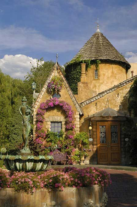 So beautiful using flowers to accent this old world style house!