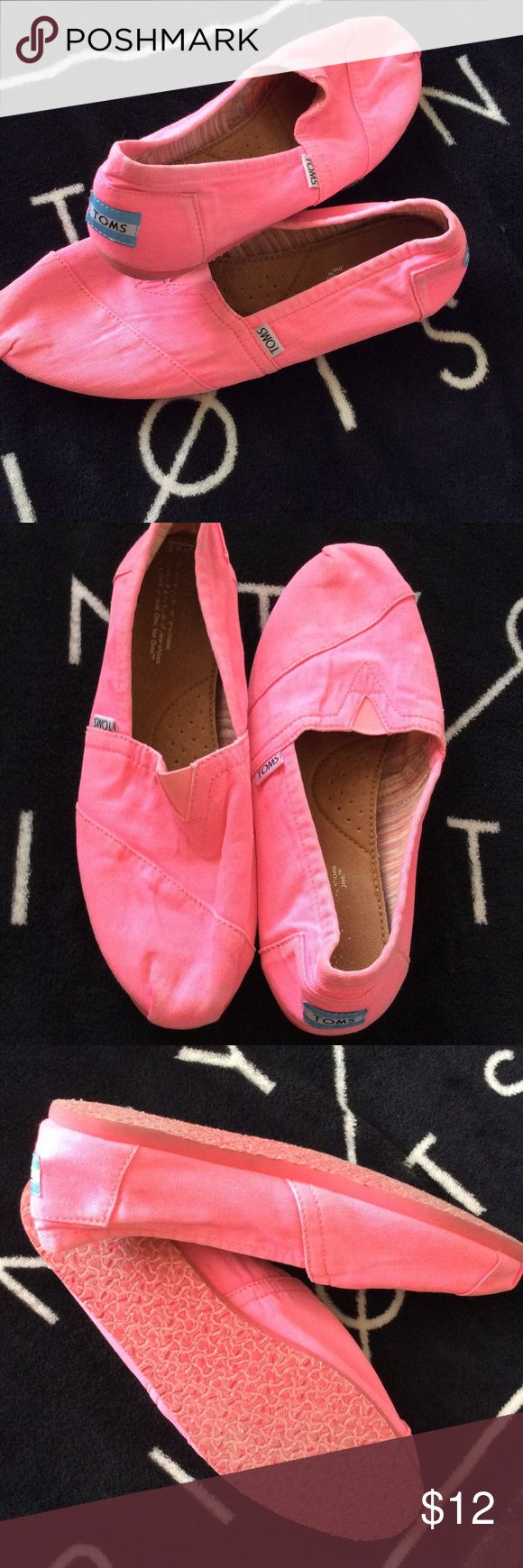 TOMS 9.5 shoes Neon pink TOMS size 9.5 great condition a little dusty from storage. Factory distressed look, not dirty. Hardly worn. TOMS Shoes Flats & Loafers