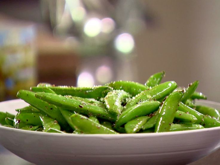 "Trying hard to incorporate lots of veggies lately...these are a super easy side - ""Sauteed Sugar Snap Peas from FoodNetwork.com"""