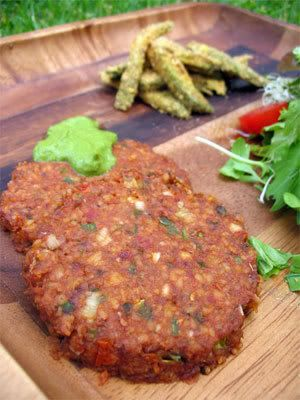 Jalapeno Burgers  From The Daily Raw Cafe  Posted by Ocean on Raw Freedom Community    1 jalapeño pepper, finely chopped  1/2 onion, finely chopped  1 cup walnuts, soaked for 4 hours  1/4 cup sun-dried tomatoes, soaked until very soft, reserve 1/8 cup soaking water  1 tablespoon Nama Shoyu  1 teaspoon Hamburger seasonings  1 teaspoon sea salt  1/2 teaspoon black pepper